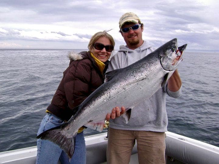 Couple holding nice salmon catch