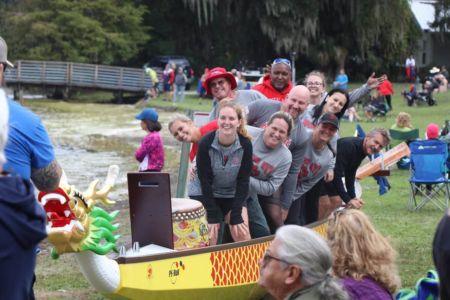 Photo of a Dragonboat team smiling in their boat