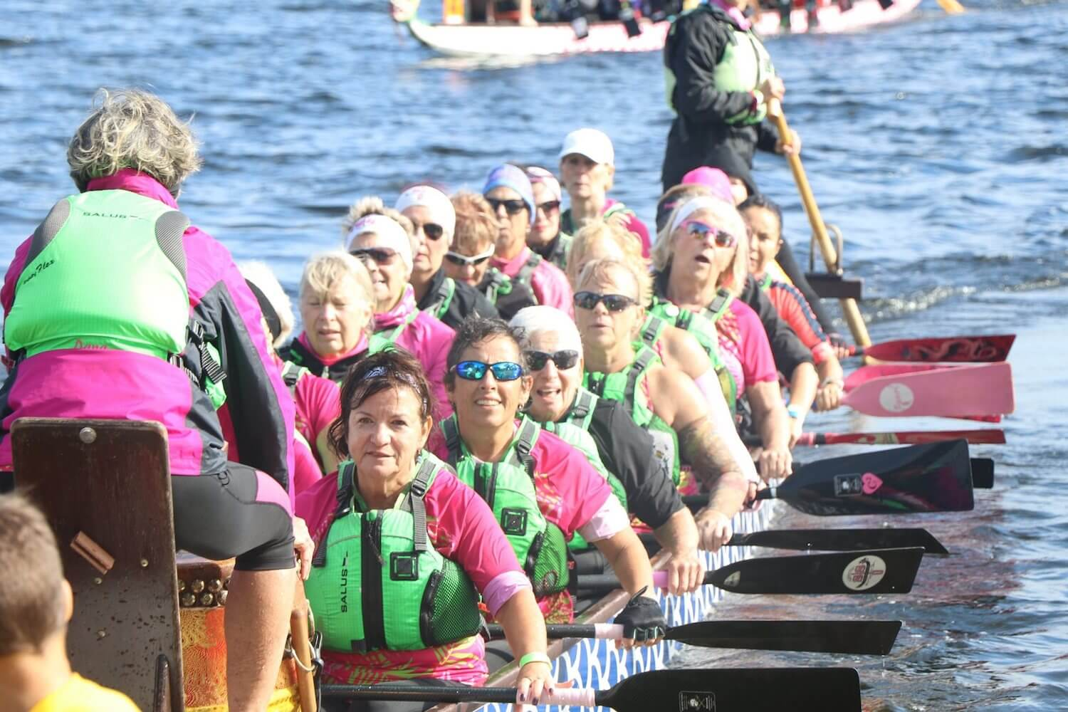 Photo of a women's Dragonboat team in their boat