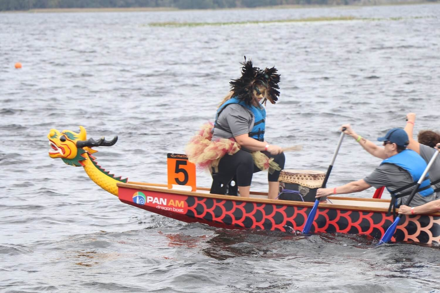 Photo of a drummer on the bow of a dragonboat