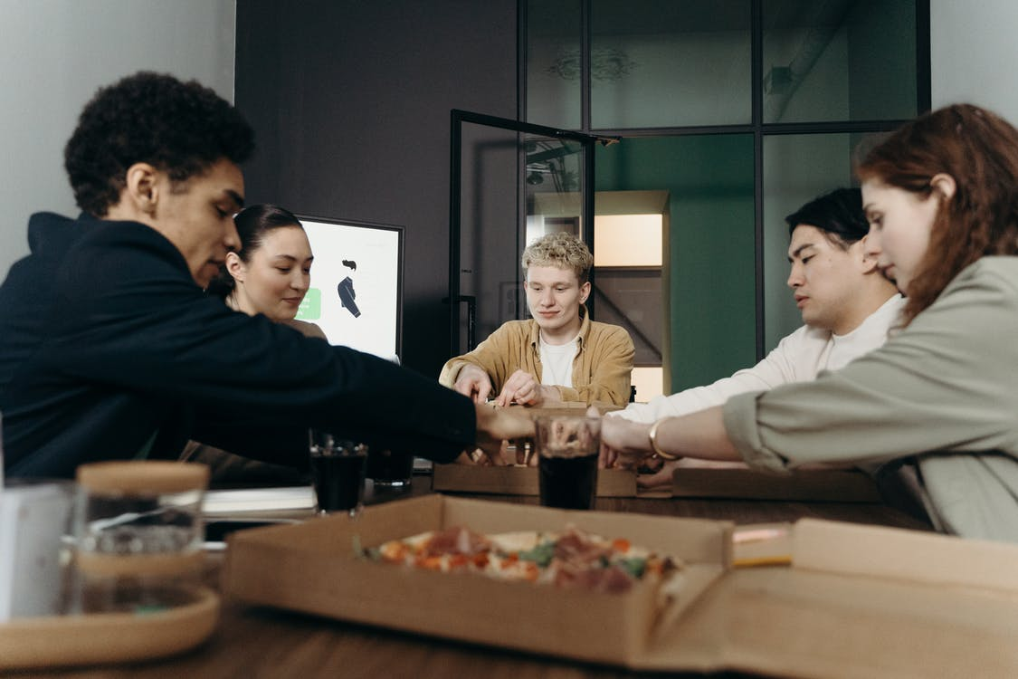 People Eating Pizza in the Office