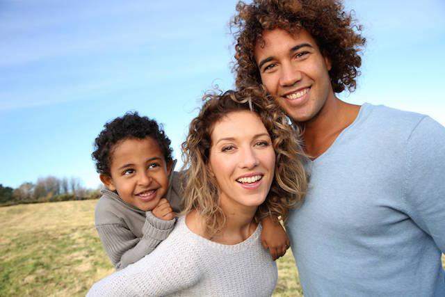 a young family smiles outside | General Dentistry in Dee Why NSW