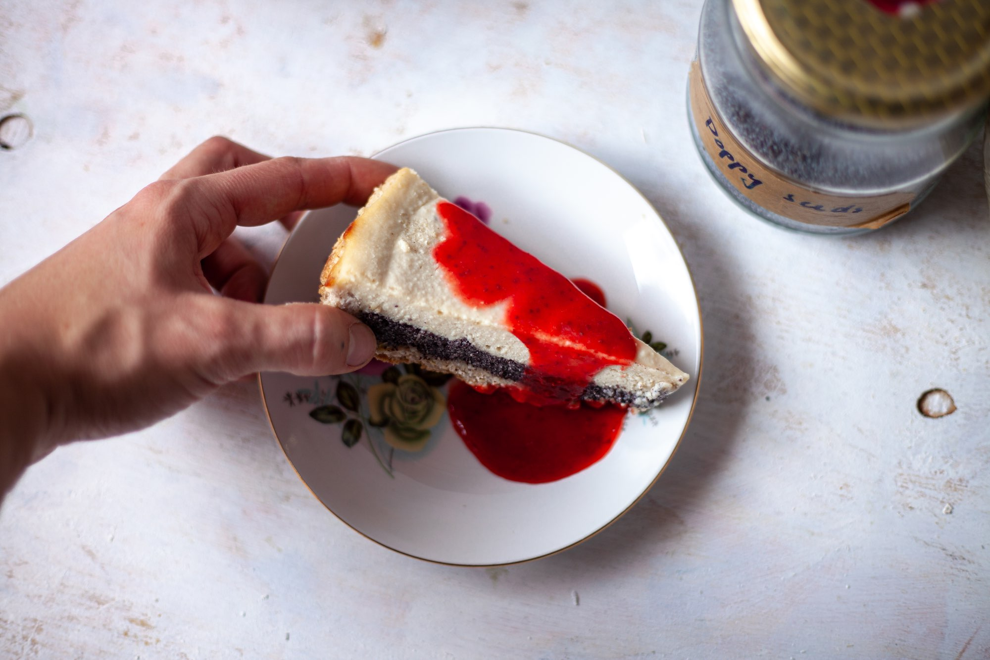 Lemon poppy seed cheesecake with strawberry coulis