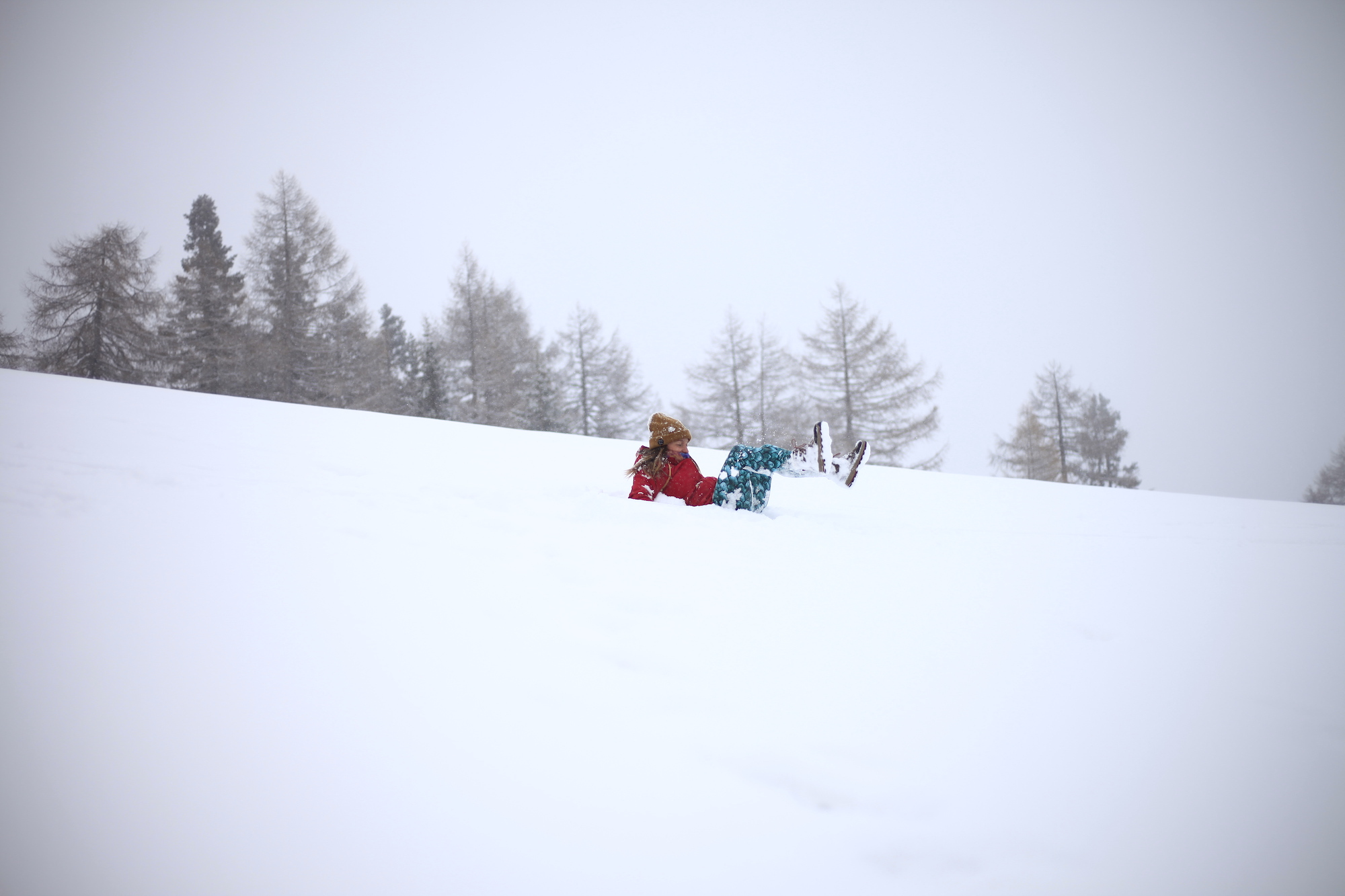 Playing in the fresh snow at MoaAlm Mountain Retreat, Austria