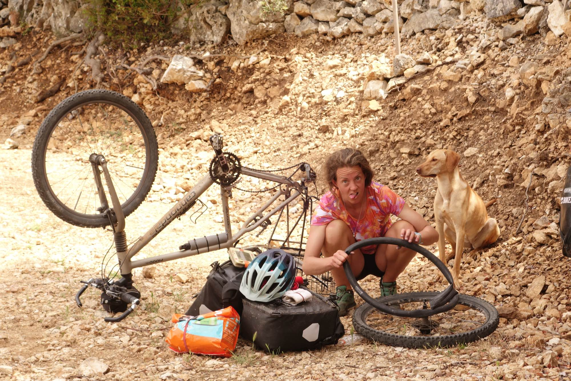 Repairing a puncture on the bike in Croatia