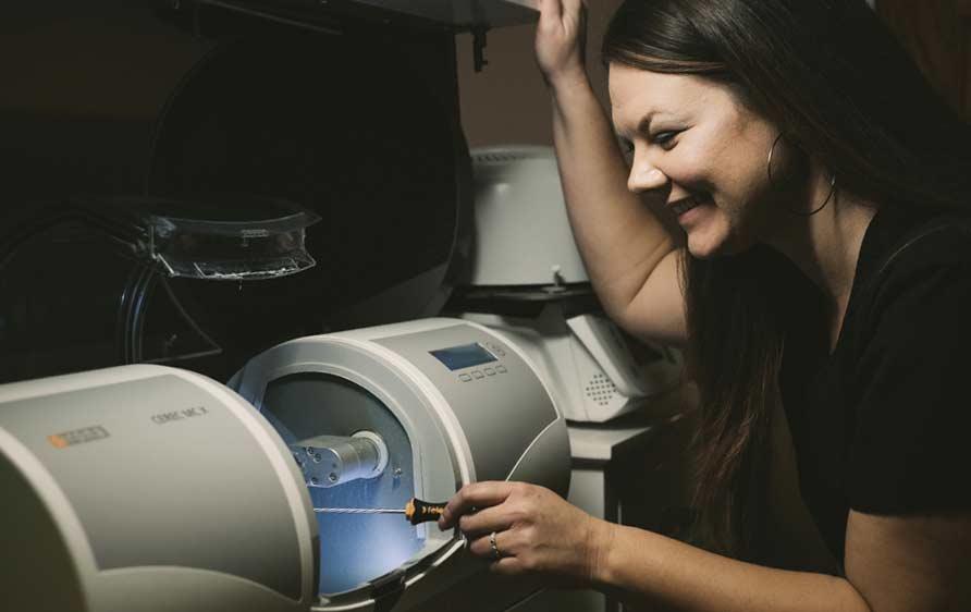 Photo of staff member operating a CEREC machine