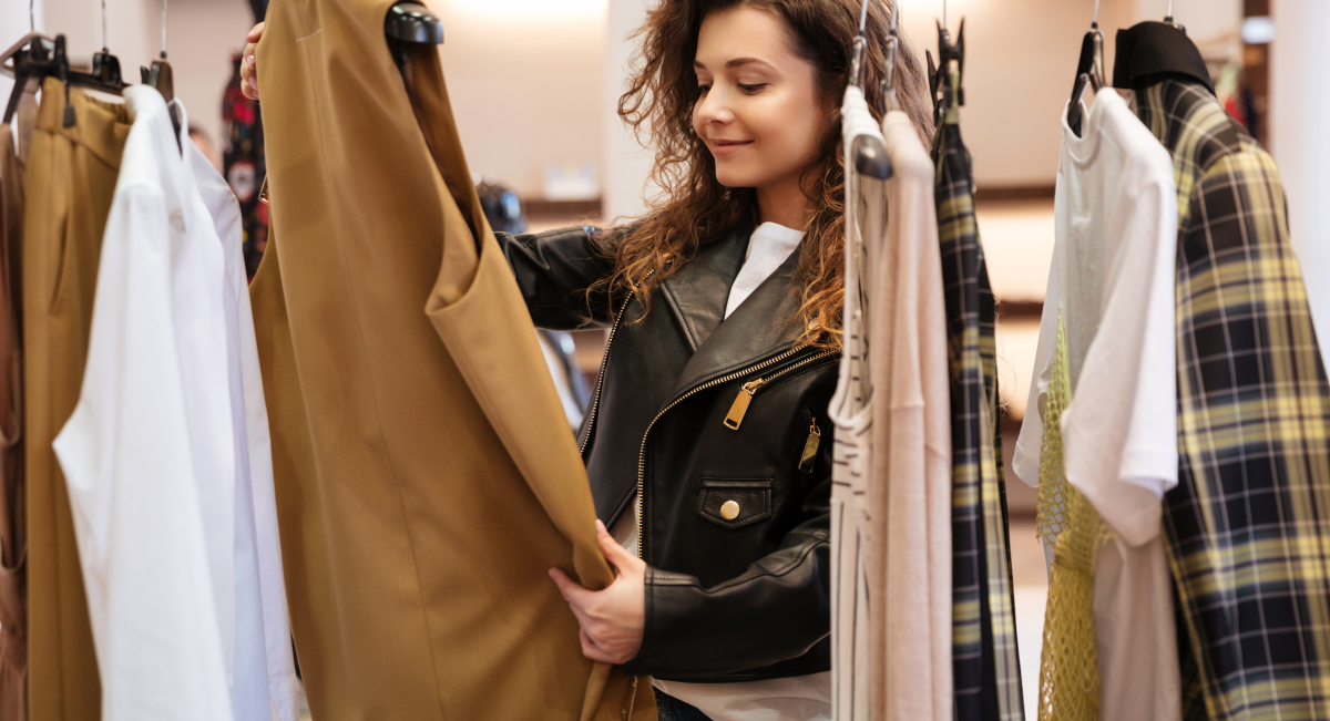Lady looking at clothing in a store image