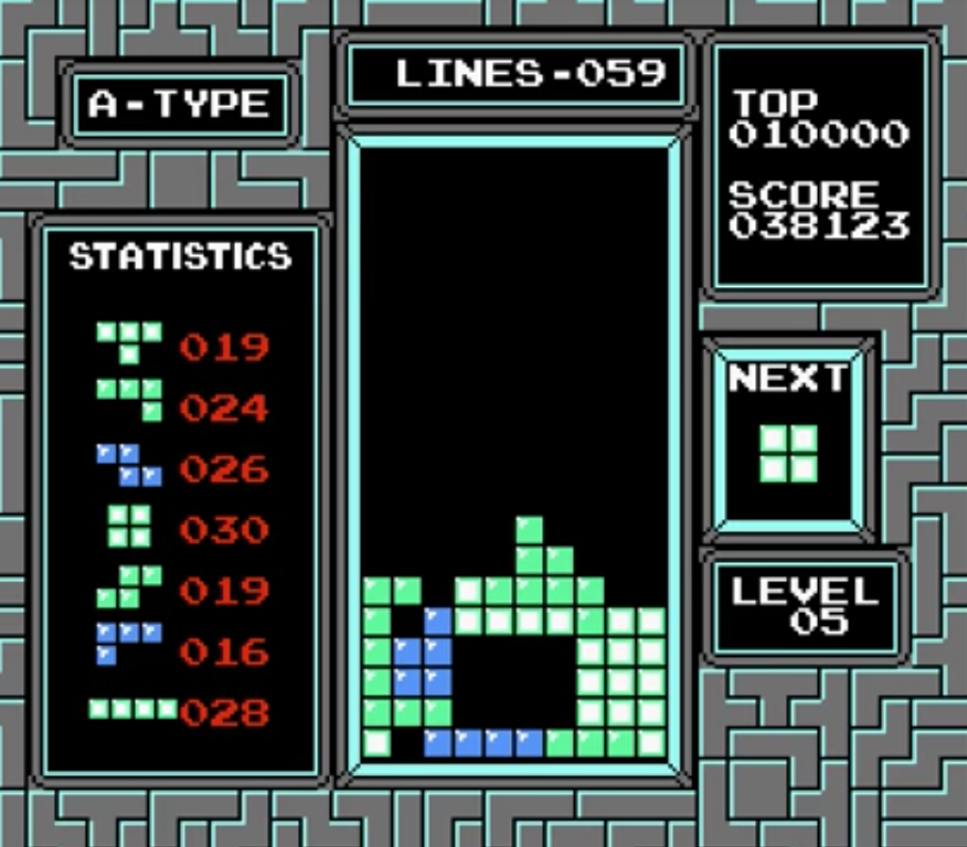 This is a screenshot of tetris nes showing a classic game of tetris that illustrates a psychological need to complete.
