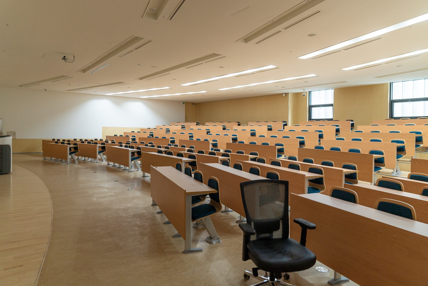 This is an image of an empty university lecture hall used to illustrate the fact that there was low webinar attendance early on in Acuity's webinar program.