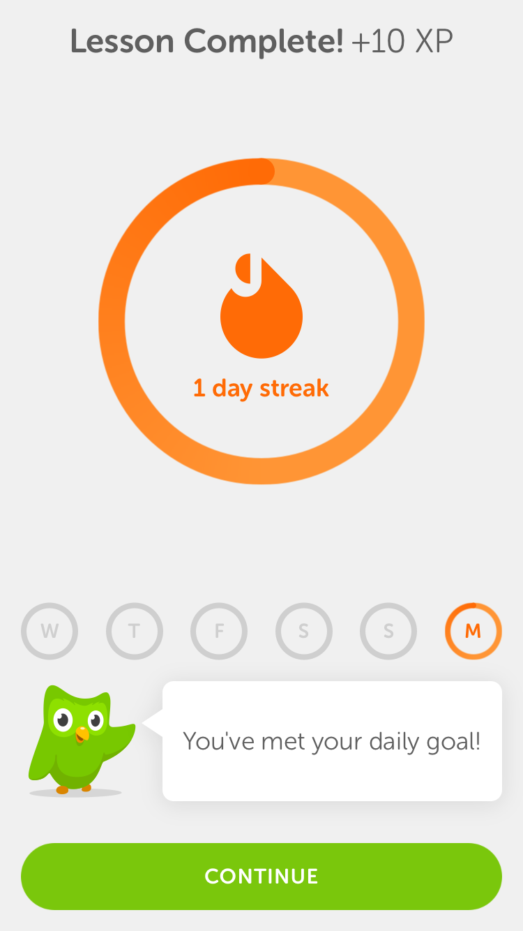 This is a screenshot of Duolingo's mobile app showing a completed lesson. There is a fire icon that says 1 day streak in orange.