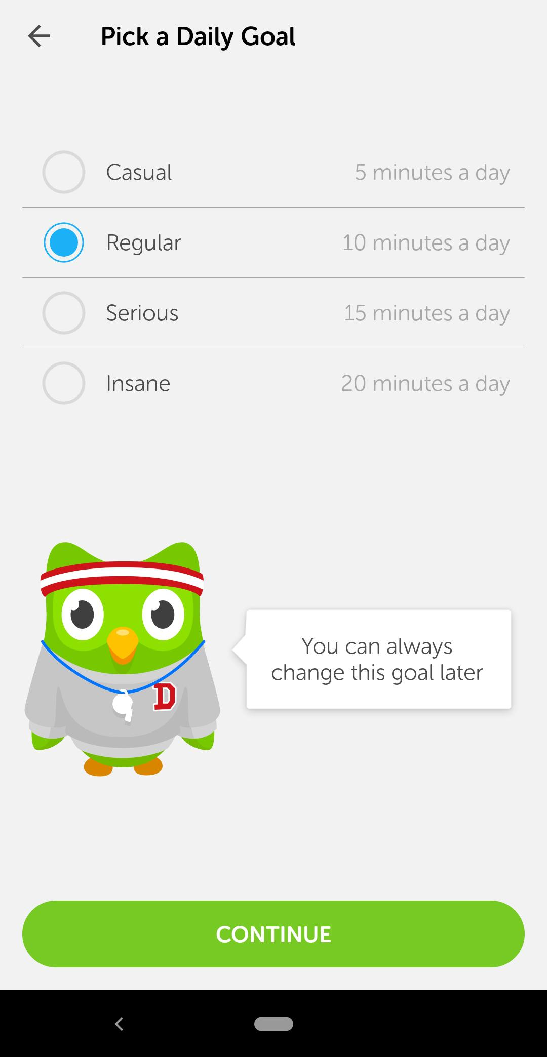 "This is a screenshot of Duolingo's onboarding process in which users are asked to set a goal. Goal setting is a powerful motivator in user onboarding. There is an owl in a sweatshirt and gym gear and the title says ""pick a daily goal""."