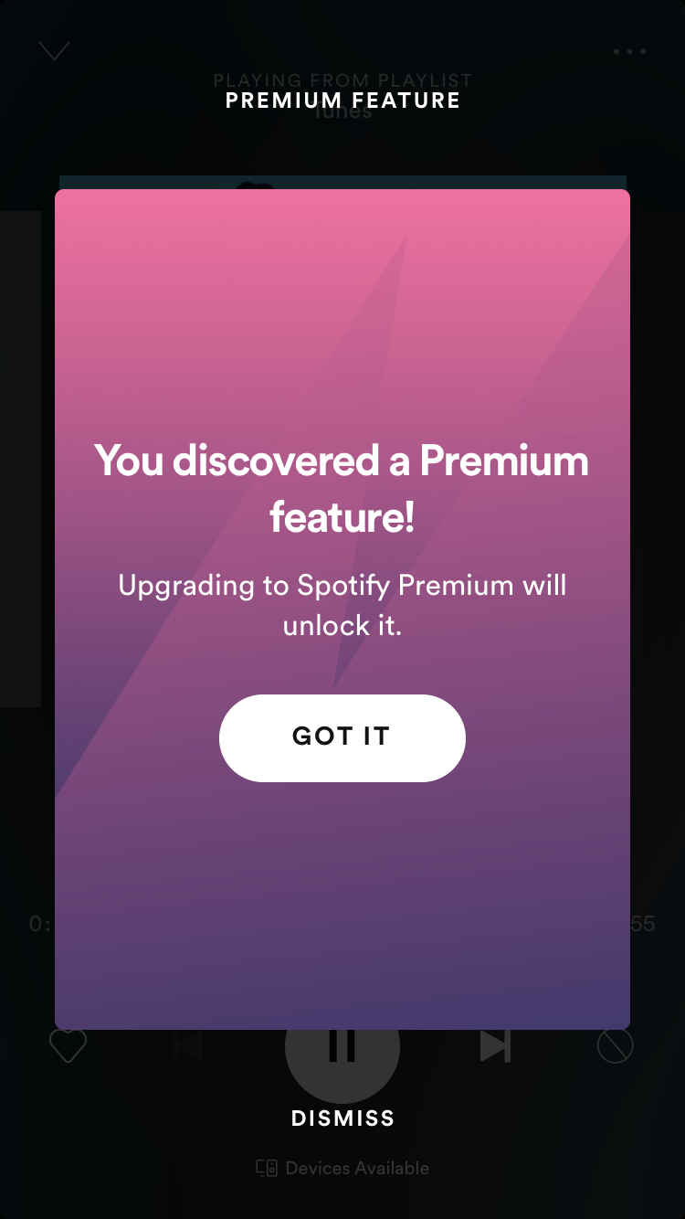 mobile screenshot of the spotify music app free version with a mobile modal window popup that says: you discovered a premium feature