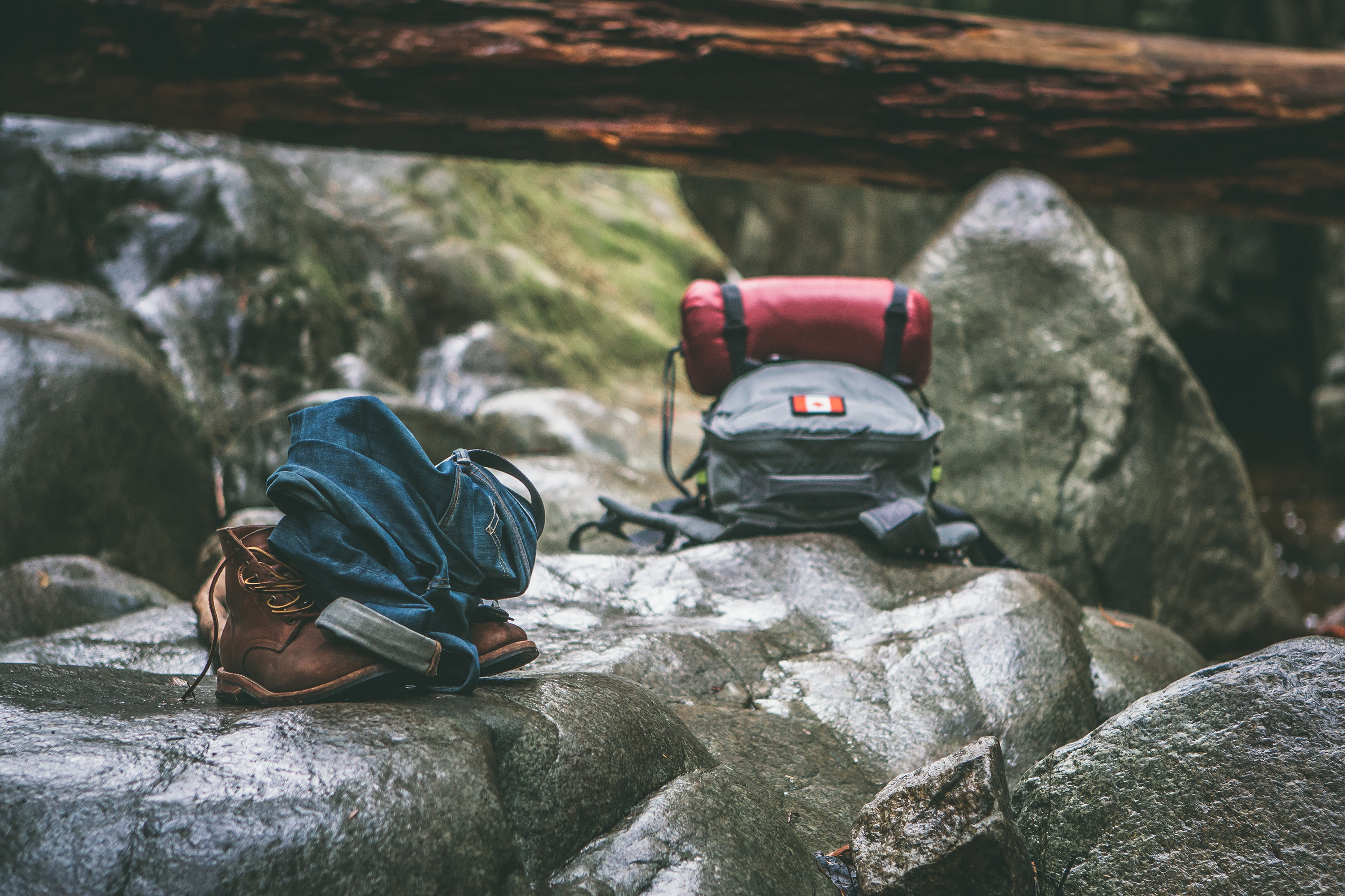 hiking backpacks on rocks