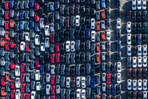 Lots of parked cars waiting to be shipped overseas