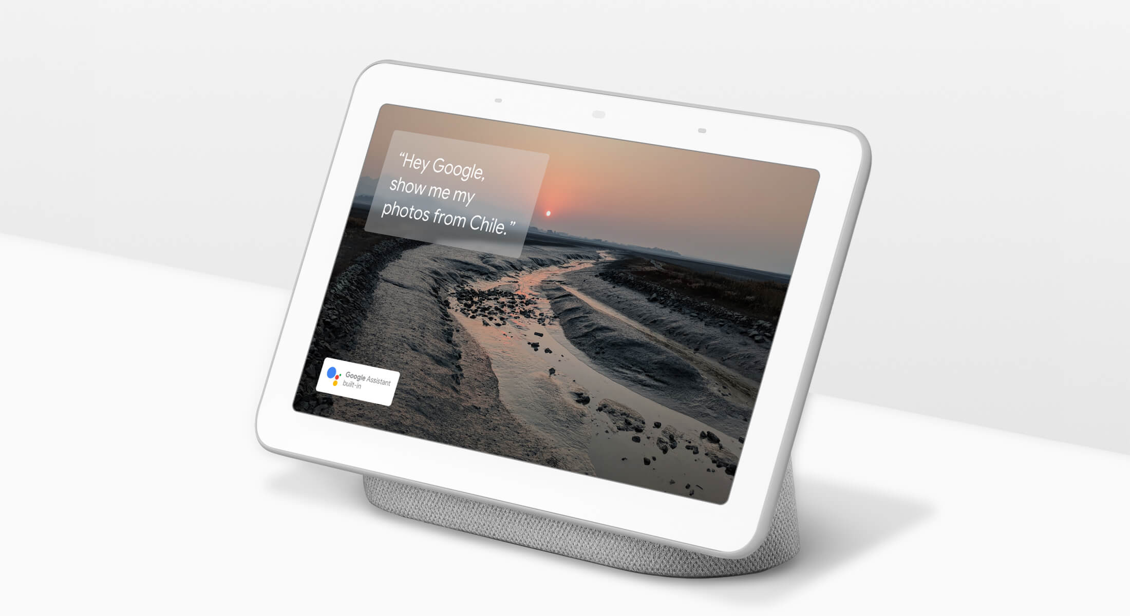Google Home Hub with home screen image.