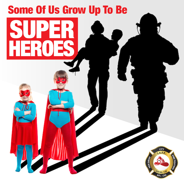 Children dressed up as super heroes with a reflection of them as firefighters.
