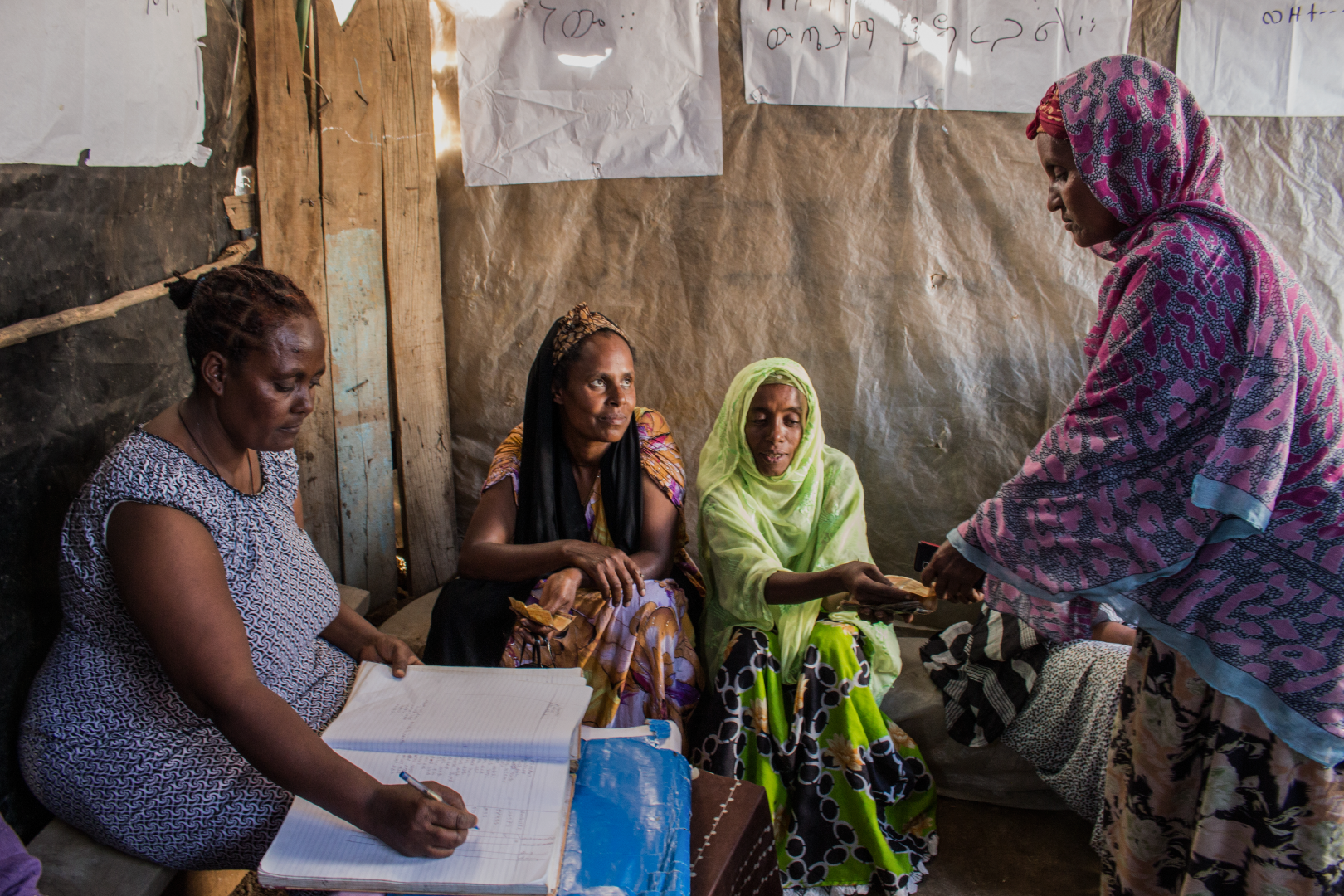Members of a self-help group in Ethiopia keep detailed records on savings and loan progress.