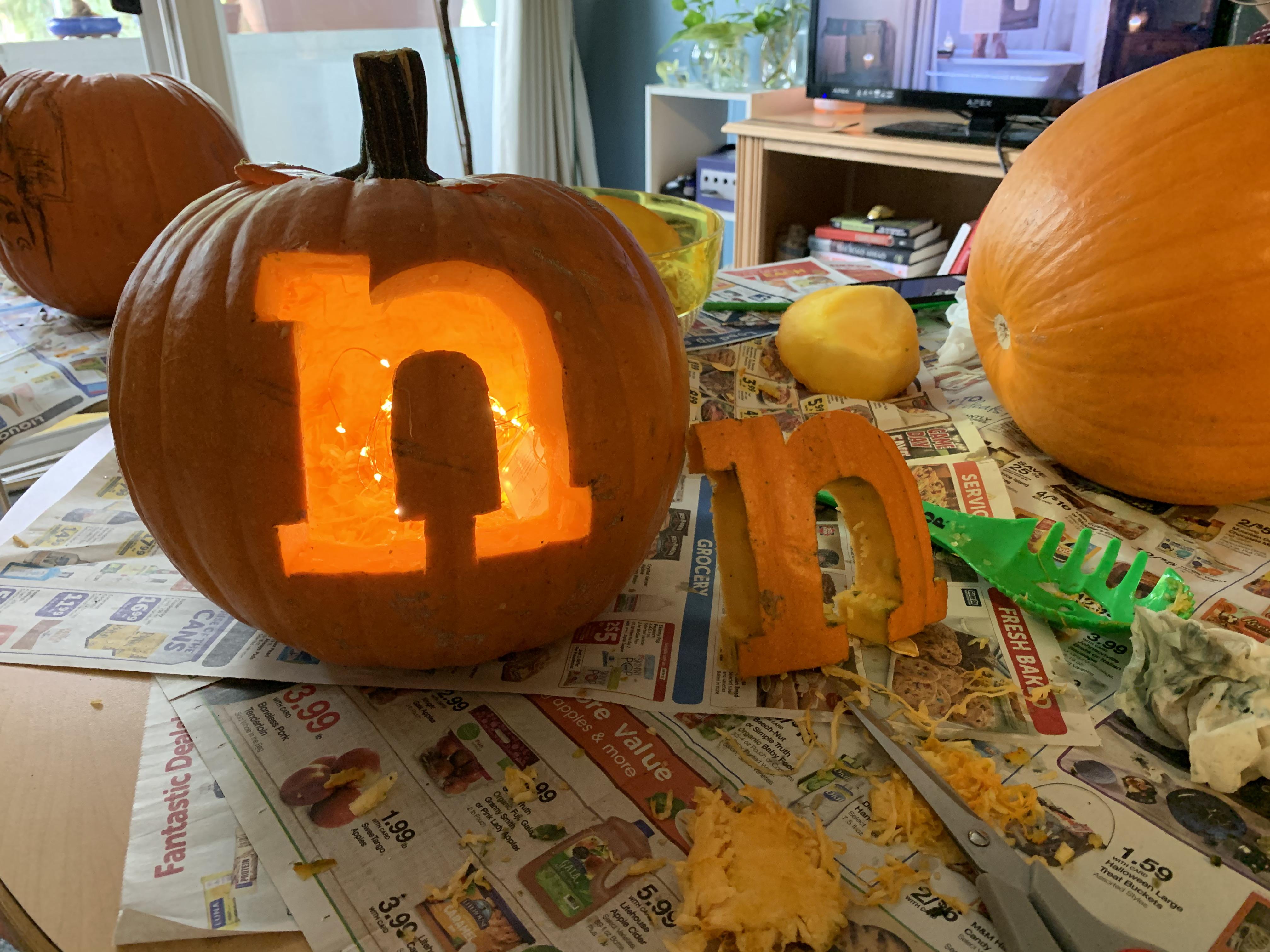 The Nectir logo carved into a Halloween pumpkin.