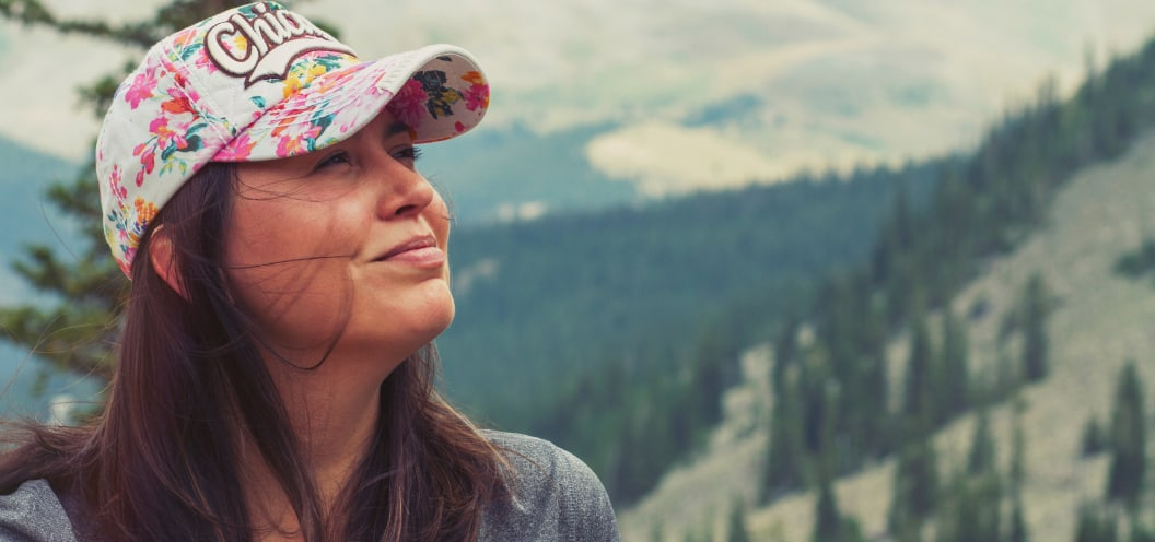 woman looking happy in the mountains