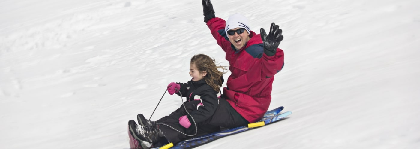 father-and-daughter-sledding