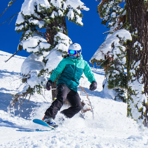 man skiing in white powder