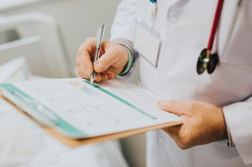 A physician charting medical records