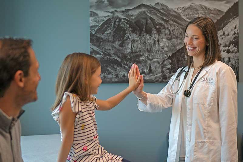 Rebecca Bub DO examining pediatric patient at Pure Family Medicine in Littleton Colorado