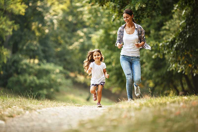 Mother and daughter running and happy with lower costs at Pure Family Medicine in Denver