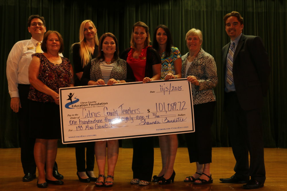Recipients of the check from the Mini-Grants Awards Gala