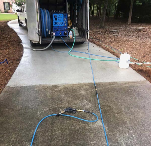 Pressure washing concrete in Monroe, GA