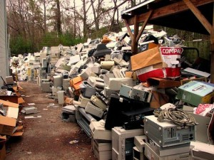 mounds of used computer equipment outside