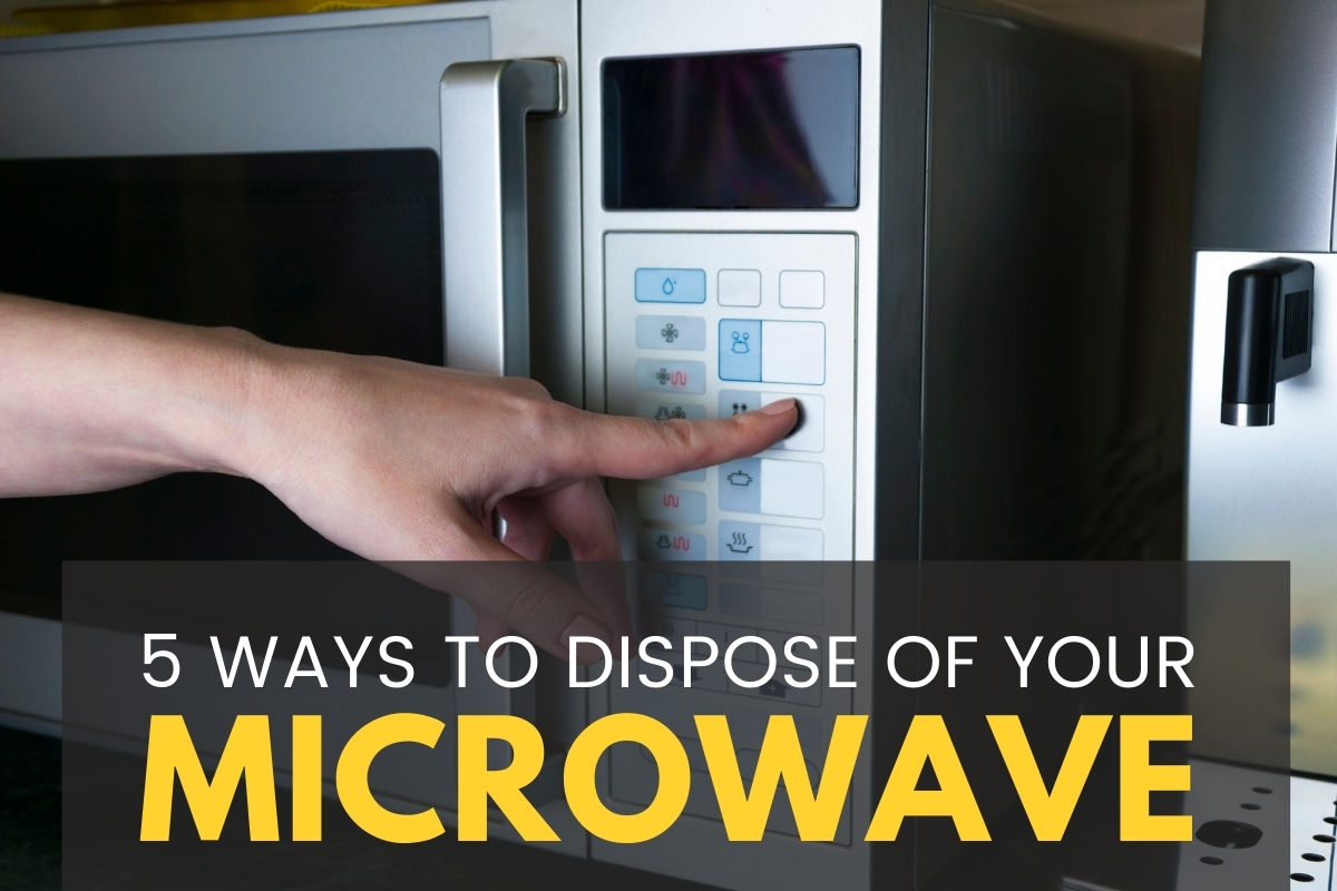 Hand using a microwave - 5 Ways To Dispose Of Your Microwave