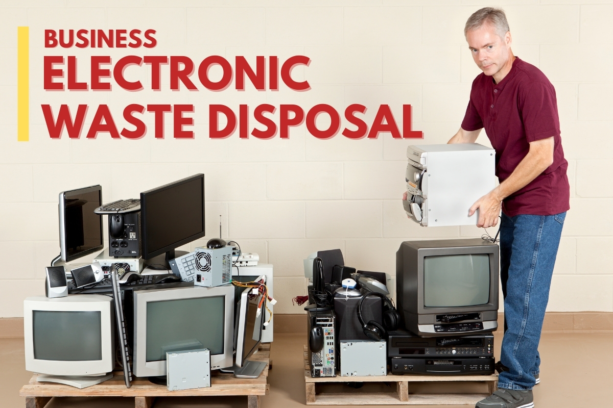Man stacking unused electronics - Business Electronic Waste Disposal