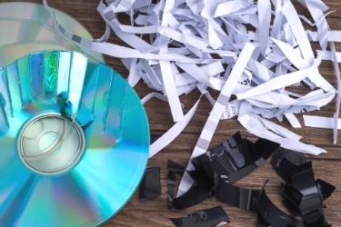Data Destruction - Shredded paper and broken CDs