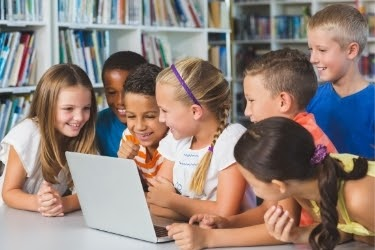 Kids playing with a donated laptop