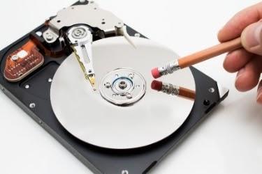 Erase Data Concept - Eraser near a hard disk