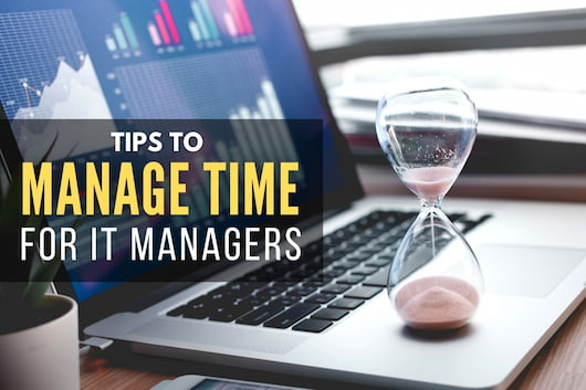 Sand Clock on top of a laptop - How to Manage Time for IT Managers