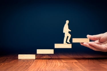 Personal development concept - person stepping up