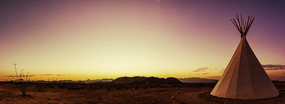 Native American teepee at dusk.