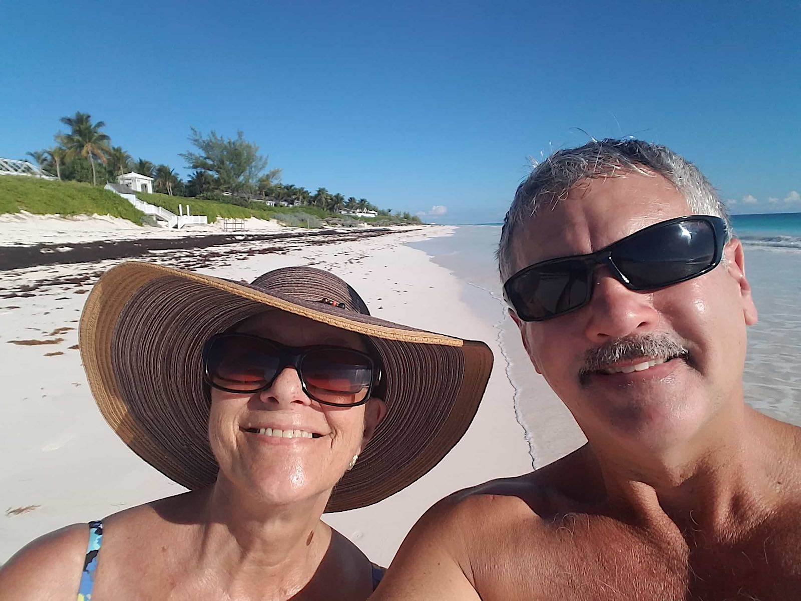 gail taking a selfie with man on the beach