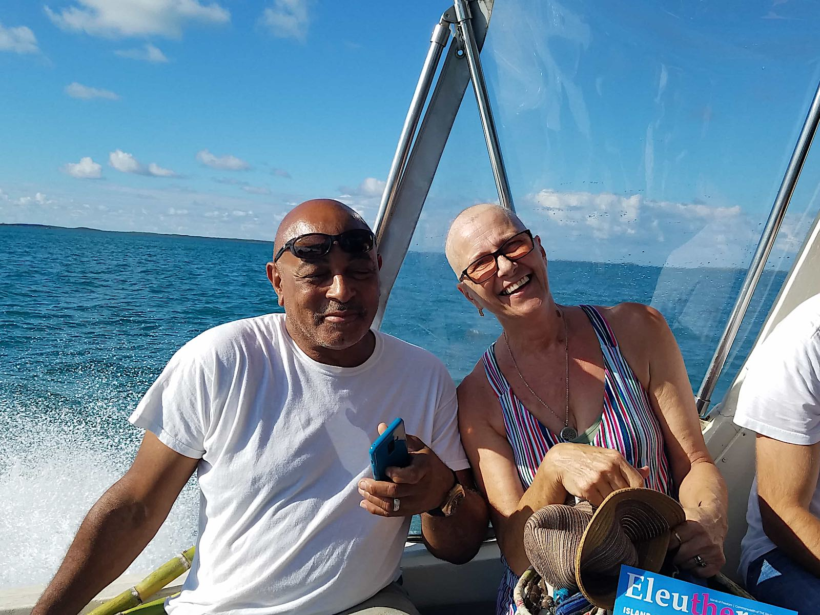 gail and a man smiling on a boat