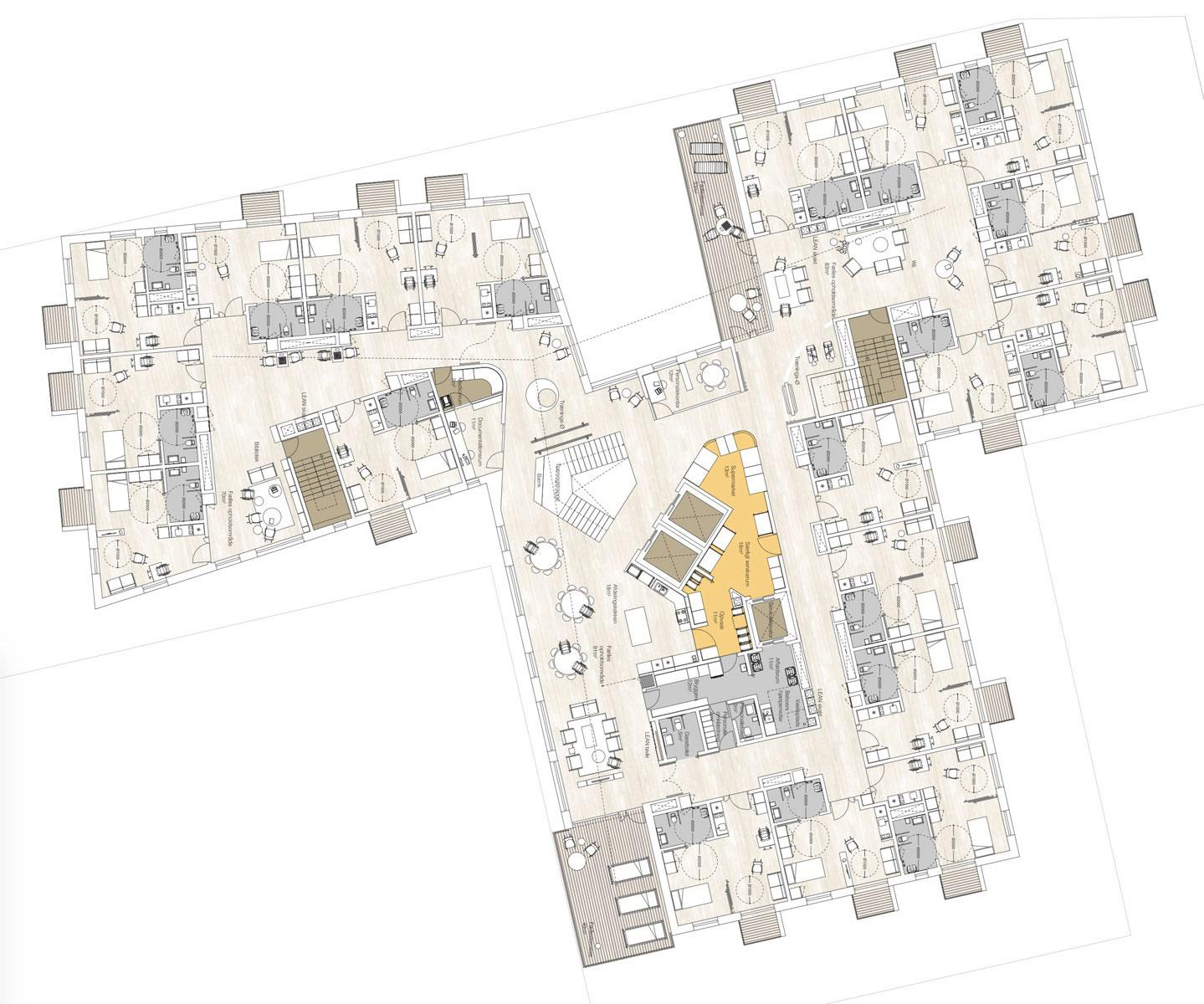 Billedet viser situationsplan for en etage. De individuelle boliger er placeret rundt langs facader.