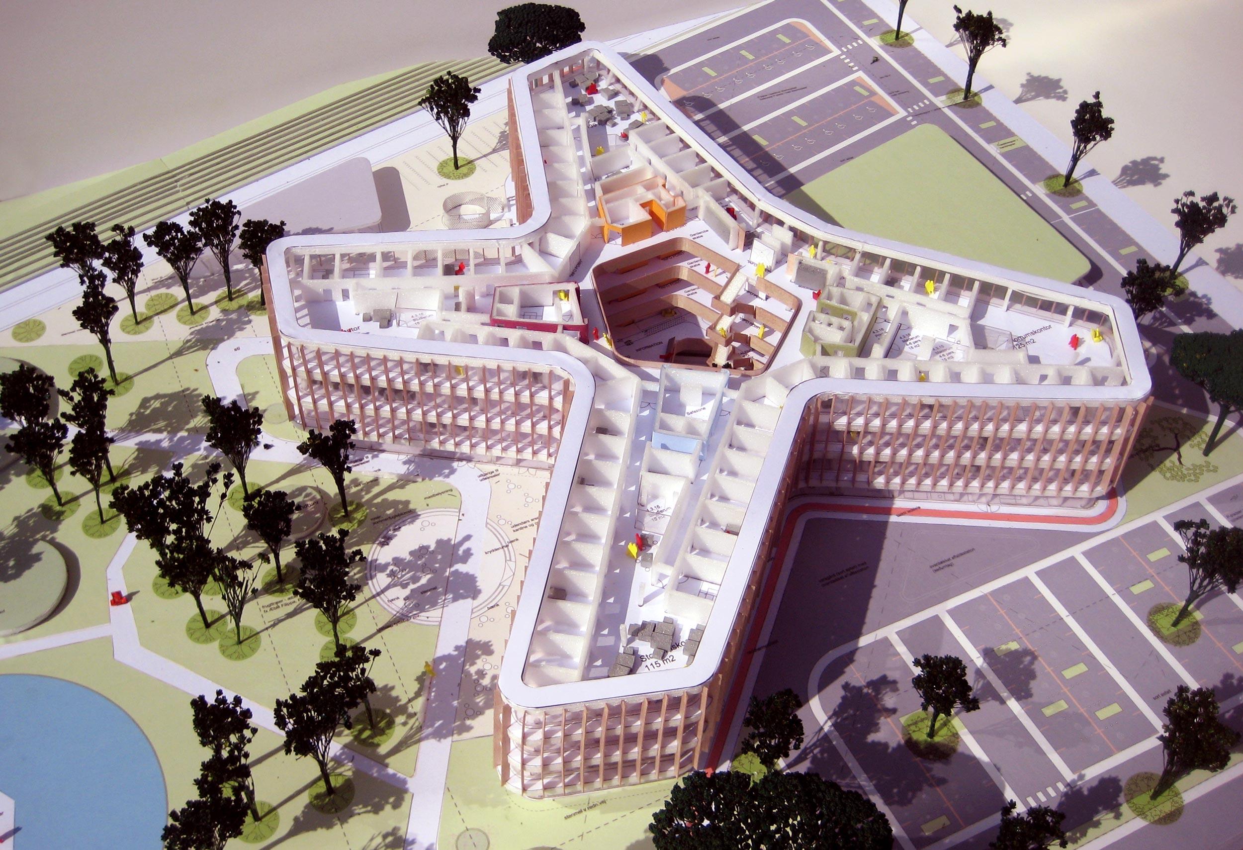Illustration af bygning med fire fløje oppefra