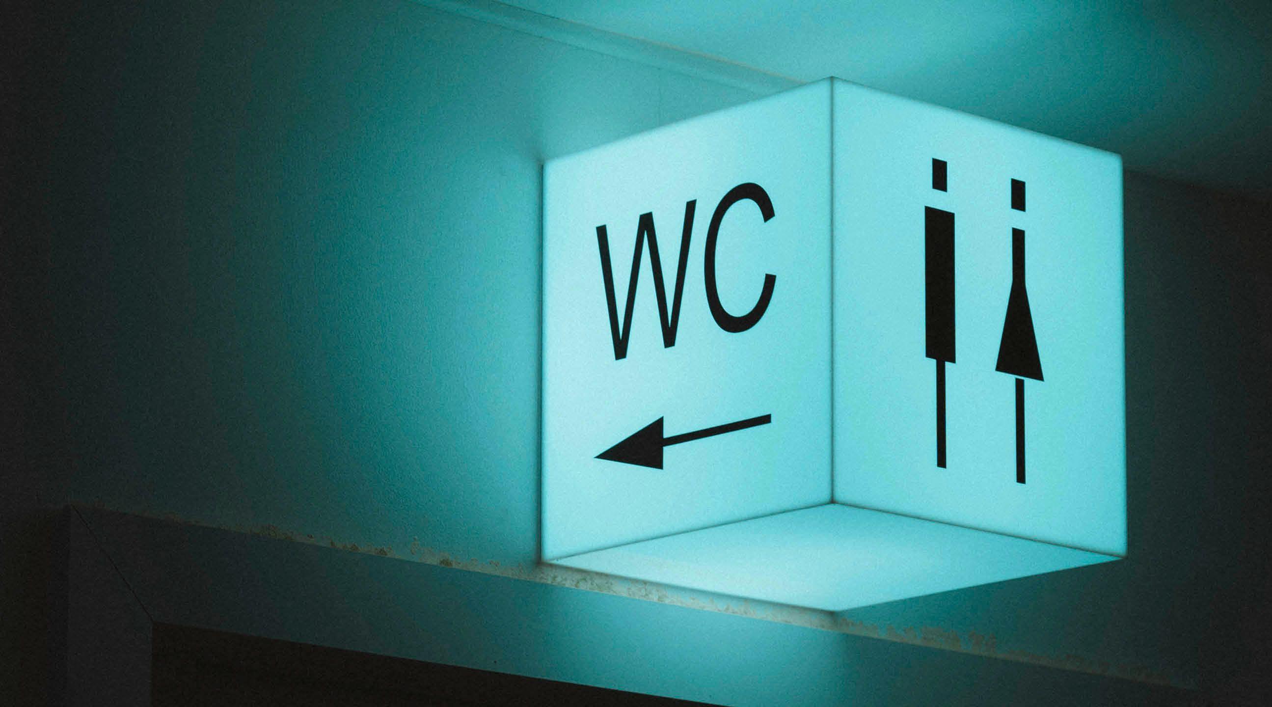 Toiletskilt hvorpå der er en kvinde og mand og står skrevet WC