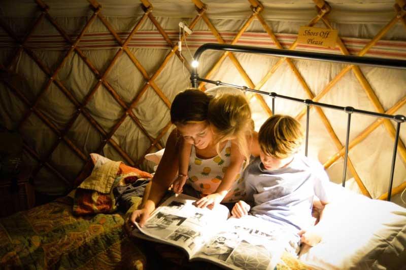 Family Reading Inside a Luxury Yurt