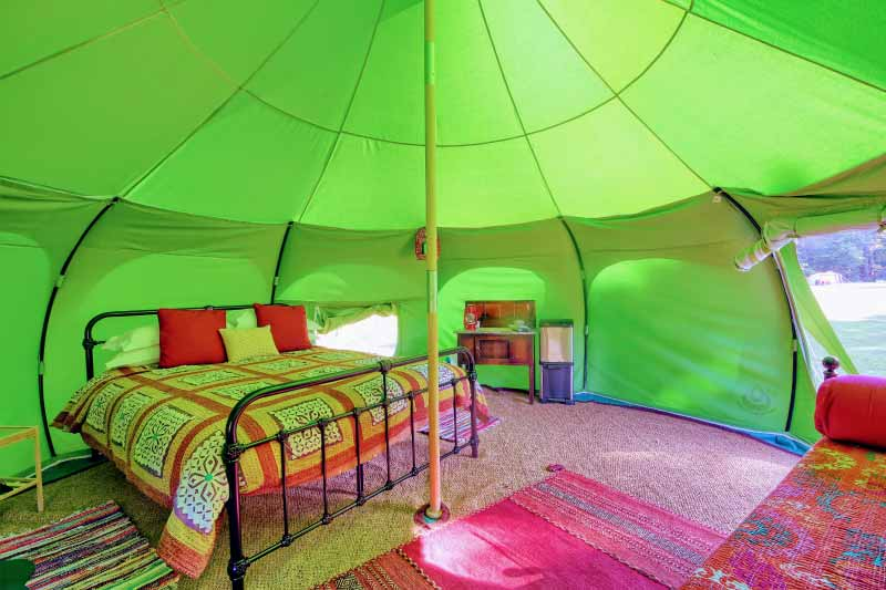 inside a lotus belle tent showing a large bed