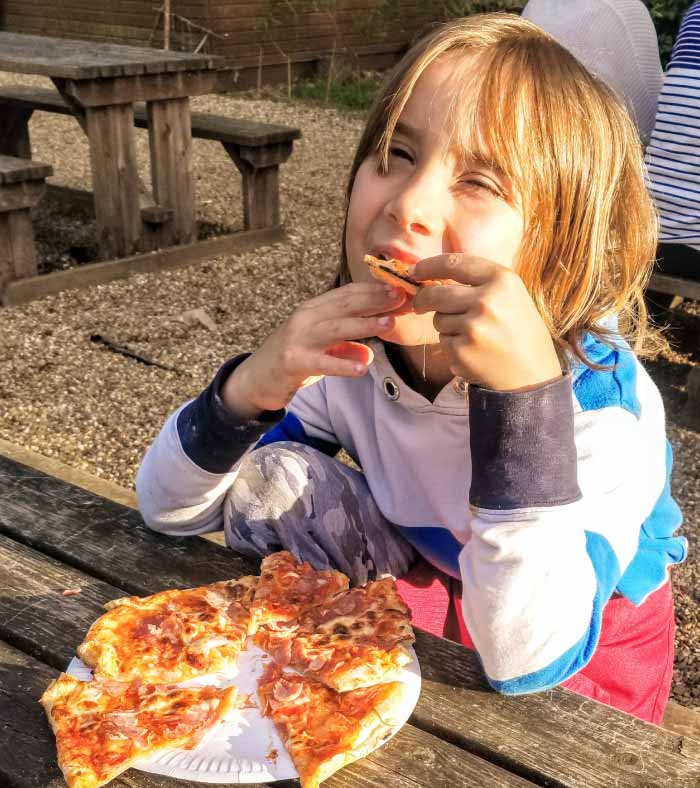 child eating pizza at swallowtails