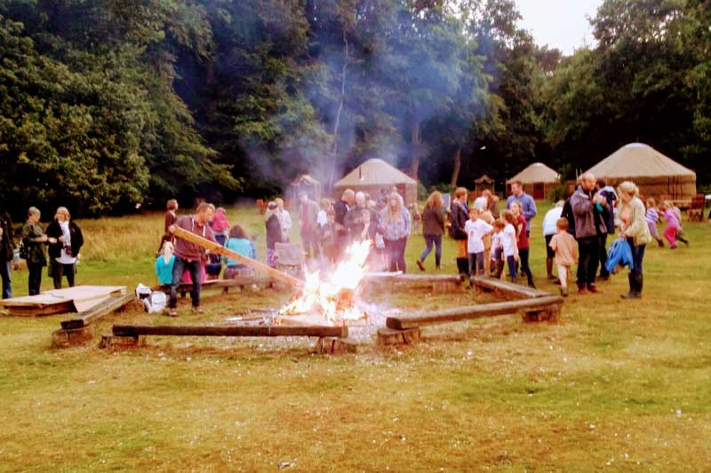 families around campfire at swallowtails