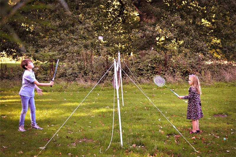 Badminton outside luxury yurt