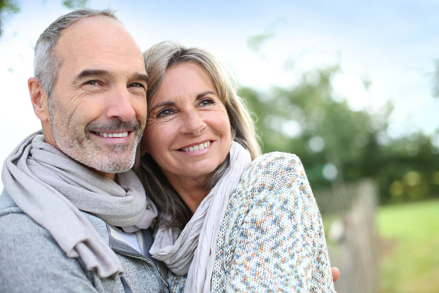 A couple with dentures smiling